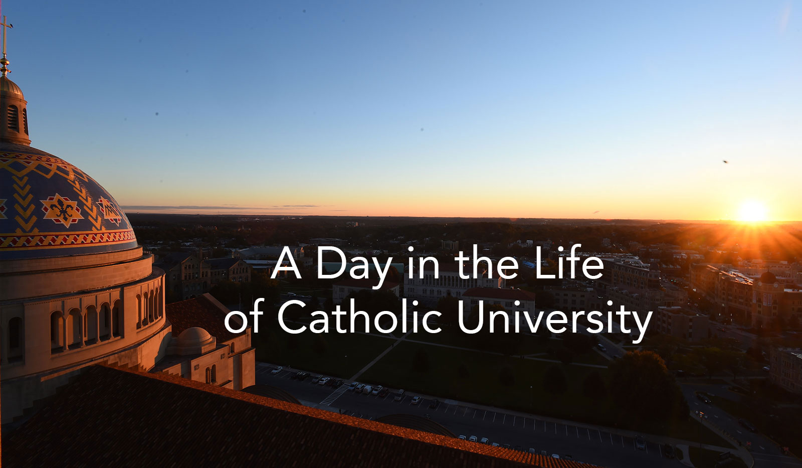 View of sunrise over campus from rooftop vantage point. A Day in the Life of Catholic University title.