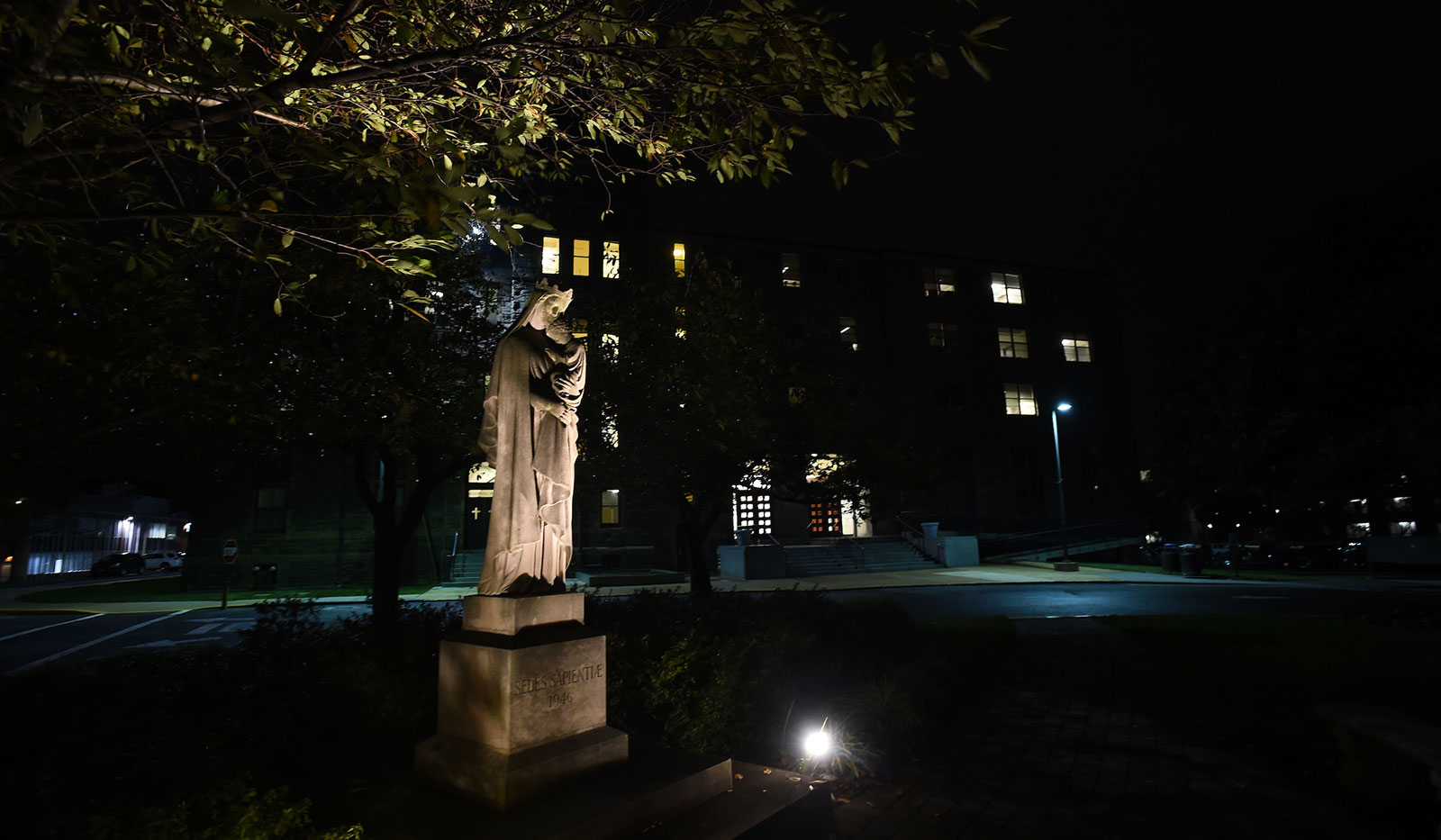 A night scene of the Mary, Seat of Wisdom statue