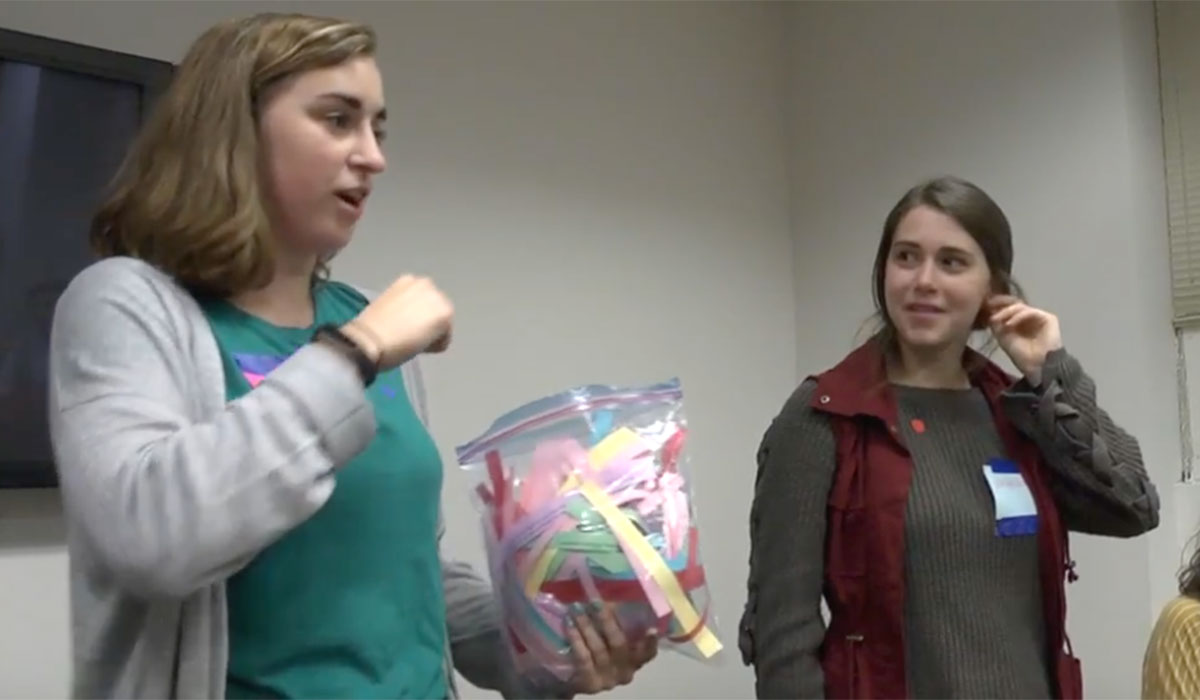 Female students participate in ice-breaker event in residence hall