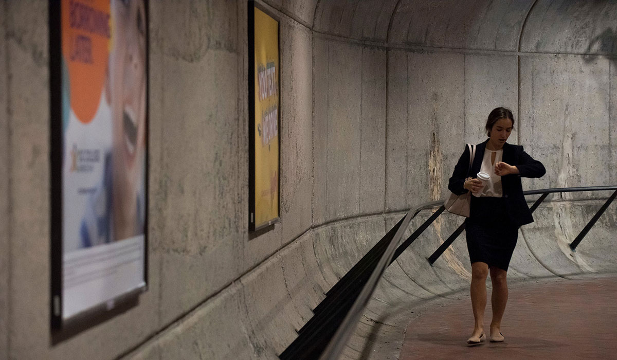 Student walking through Metro station