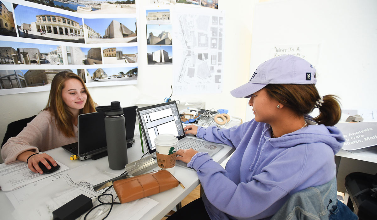 Third mosaic photo shows two female architecture students working on laptops across a desk from one another.