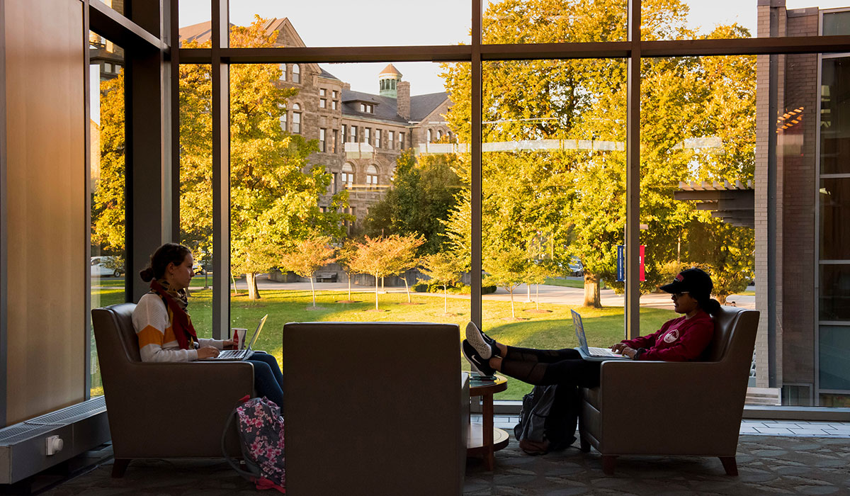 Fourth mosaic photo shows students sitting in comfortable chairs in the gallery area of the Pryz with a sunlit fall campus scene through the windows behind them.