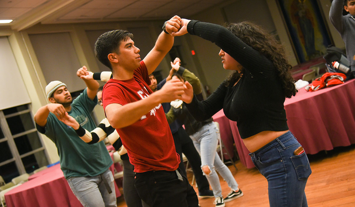 Sixth mosaic photo shows a students practicing a dance
