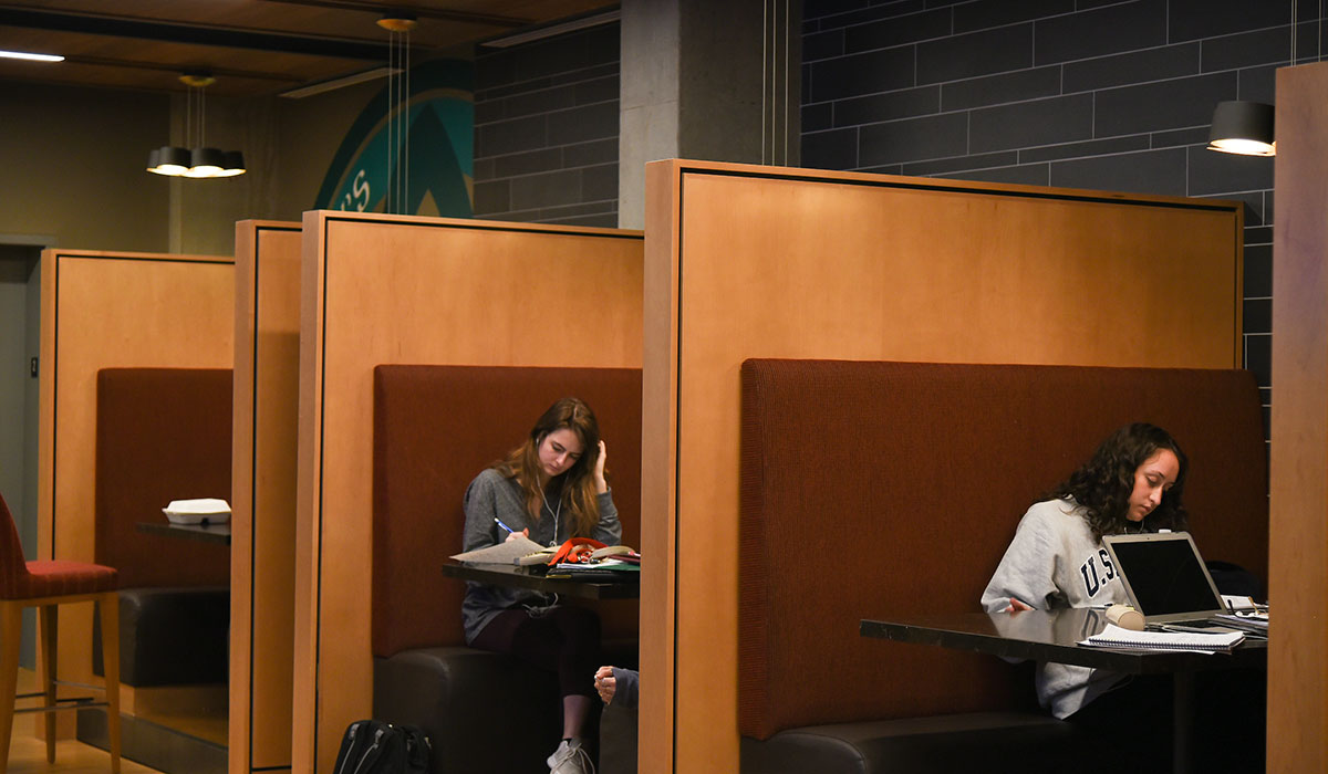 Students sitting in booths inside Murphy's Lounge